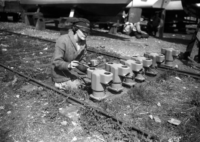 Woman Painting Engine Parts, 1920