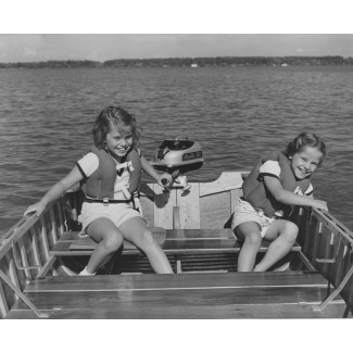 Young Girls Running an Outboard Motor, ca. 1960