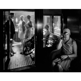 Woman on telephone in observation car, 1929
