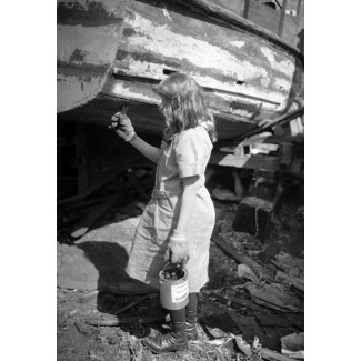 Girl Caulking Hull, 1920